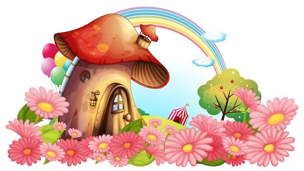 Uma casa de cogumelos com um jardim de flores