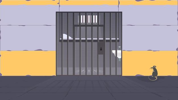 Uma cela de prisão com grade de metal