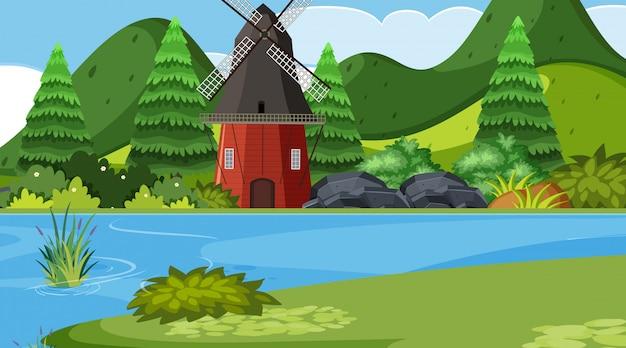 Uma cena ao ar livre com moinho de vento
