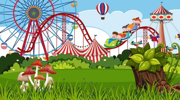 Uma cena ao ar livre com parque de diversões