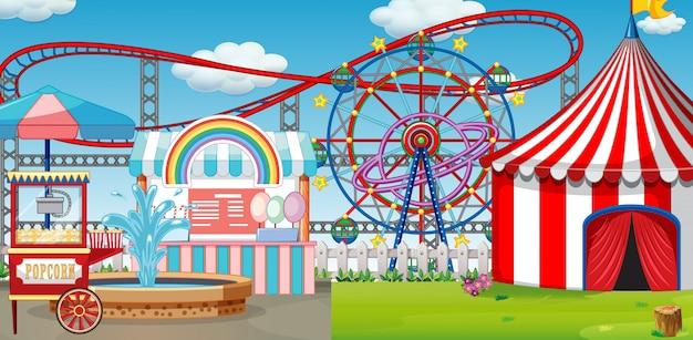 Uma cena de parque de diversões ao ar livre com montanha-russa
