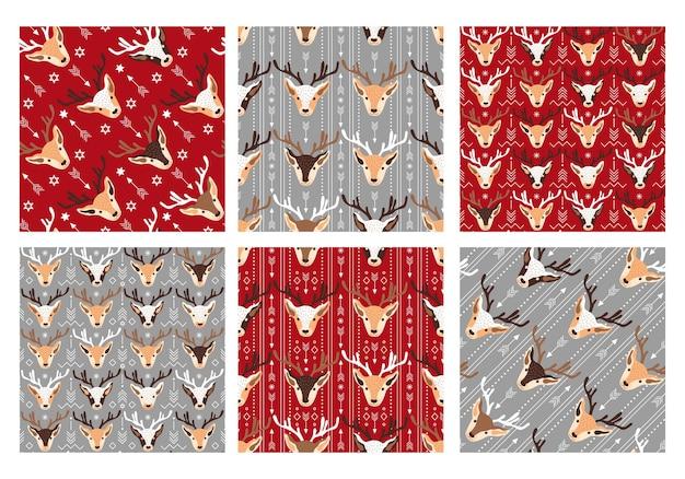 Uma coleção de padrões sem emenda com tema festivo de natal com cabeças de veado e decorações vetor il ...