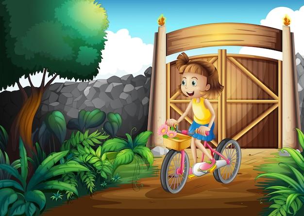 Uma criança andando de bicicleta no quintal