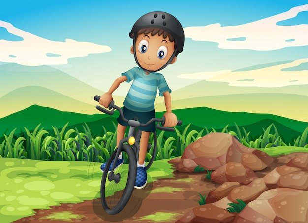 Uma criança andando de bicicleta no topo da colina