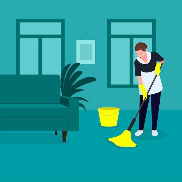 Uma empregada faz limpeza, lava o chão com um esfregão com luvas amarelas, limpa, desinfeta as superfícies do chão,