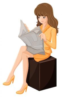 Uma empresária lendo um jornal