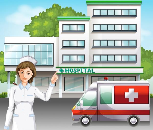 Uma enfermeira em frente ao hospital