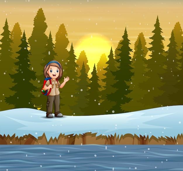 Uma escoteira na paisagem de inverno
