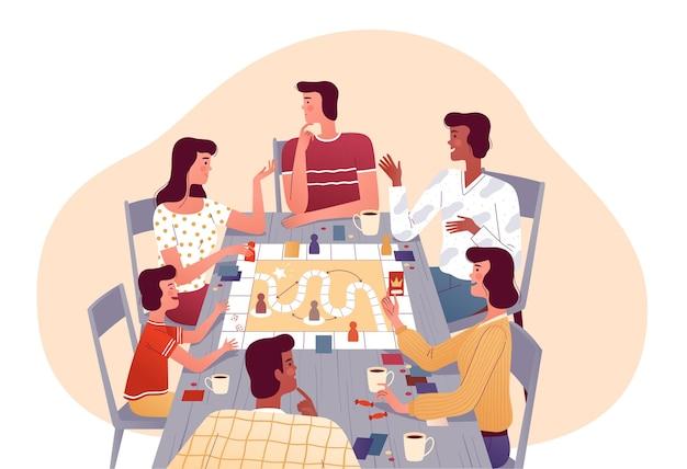 Uma família alegre joga jogos de tabuleiro com os amigos