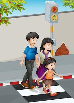 Uma família atravessando a rua