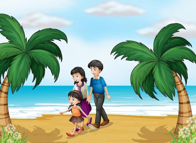 Uma família caminhando na praia