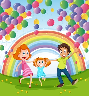 Uma família feliz perto do arco-íris e balões