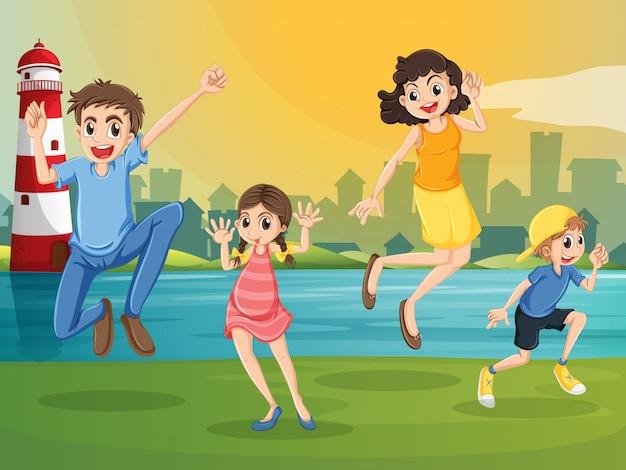 Uma família feliz pulando do outro lado do farol