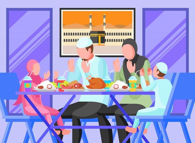 Uma família muçulmana que quebra o ramadã em jejum em casa