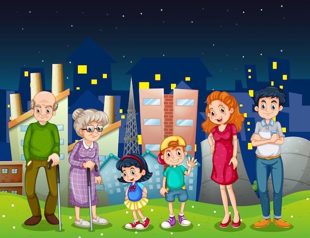 Uma família na cidade em pé na frente dos edifícios altos