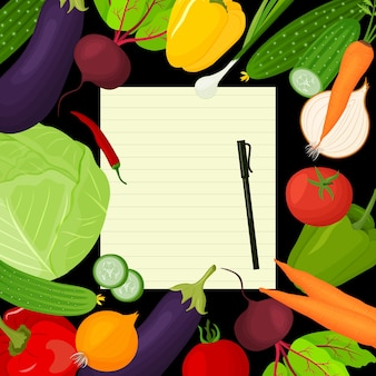 Uma folha para escrever receitas rodeada de vegetais frescos