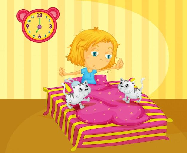 Uma garota acordando na cama com dois gatinhos