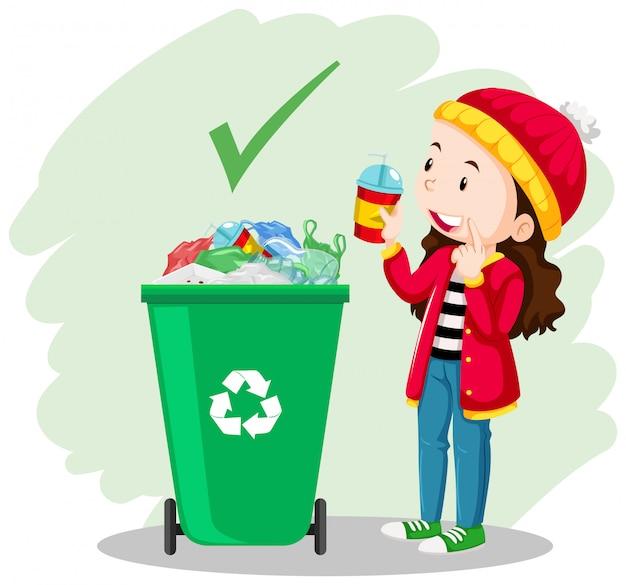 Uma garota colocar o copo na lata de lixo