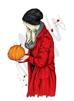 Uma garota com cabelo comprido em um casaco, chapéu e lenço de outono tem uma abóbora de halloween nas mãos.