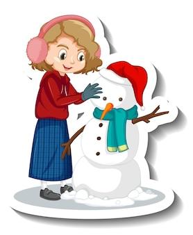 Uma garota construindo um boneco de neve com um adesivo de personagem de desenho animado