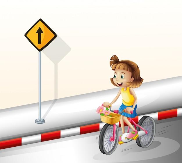 Uma garota de bicicleta na estrada