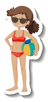 Uma garota de biquíni vermelho segurando uma bola de praia