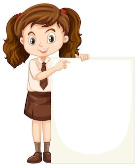Uma garota feliz com quadro em branco