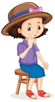 Uma garota feliz, sentado na cadeira