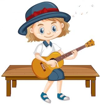 Uma garota feliz tocando violão no banco