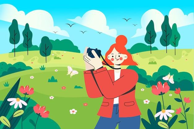 Uma garota fotografando uma paisagem natural na primavera