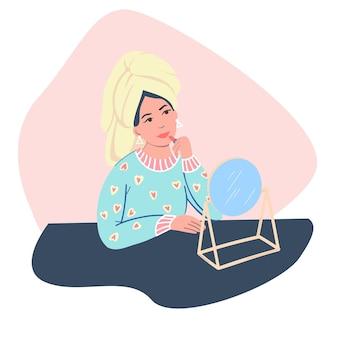 Uma garota jovem e bonita está se maquiando em frente ao espelho. uma garota com uma toalha na cabeça pinta os lábios. ilustração de desenho vetorial