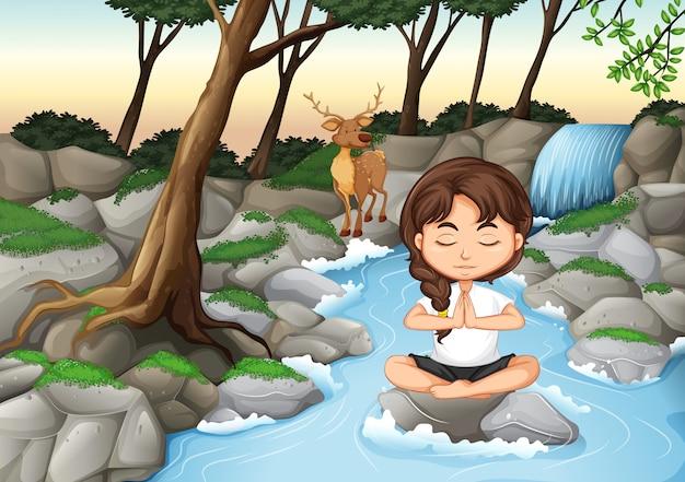 Uma garota meditar na natureza