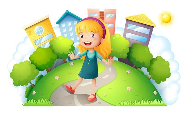 Uma garota no topo da colina com edifícios