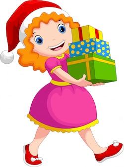 Uma garota usando um chapéu de natal segurando uma pilha de presentes