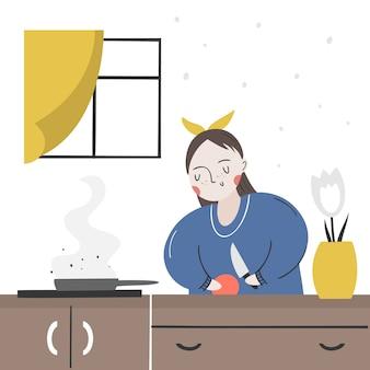 Uma garota vegana prepara comida na cozinha. alimentação saudável como estilo de vida