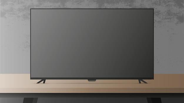 Uma grande tv está sobre a mesa.