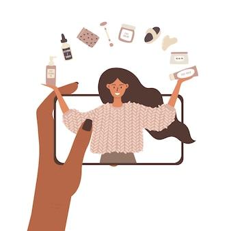Uma ilustração da mão de uma mulher segurando um telefone e assistindo ao vídeo de uma garota blogueira de beleza.