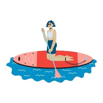 Uma jovem de joelhos na prancha de sup. mulher ajoelhada remando em sup boarding ao ar livre