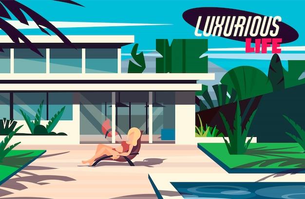 Uma jovem garota está tomando sol em uma espreguiçadeira em uma casa moderna com uma piscina.