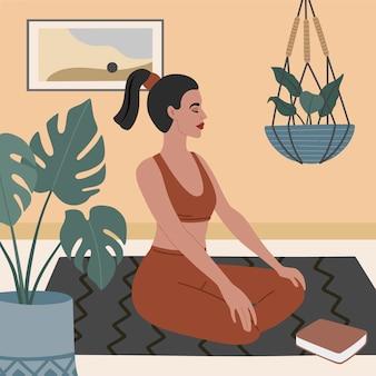 Uma jovem pratica ioga em casa, em sua aconchegante sala de estar em estilo escandinavo. prática de meditação em apartamento.