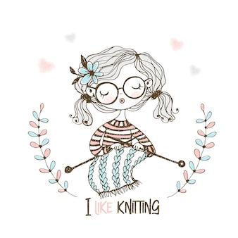 Uma linda garota tricota um cachecol em suas agulhas de tricô.