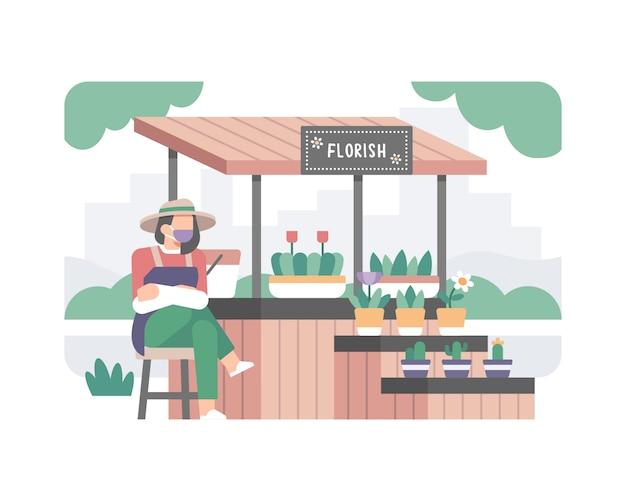 Uma linda garota usando uma máscara e vendendo uma flor e uma planta tropical linke cactus dan monstera sai em sua pequena ilustração de loja fofa