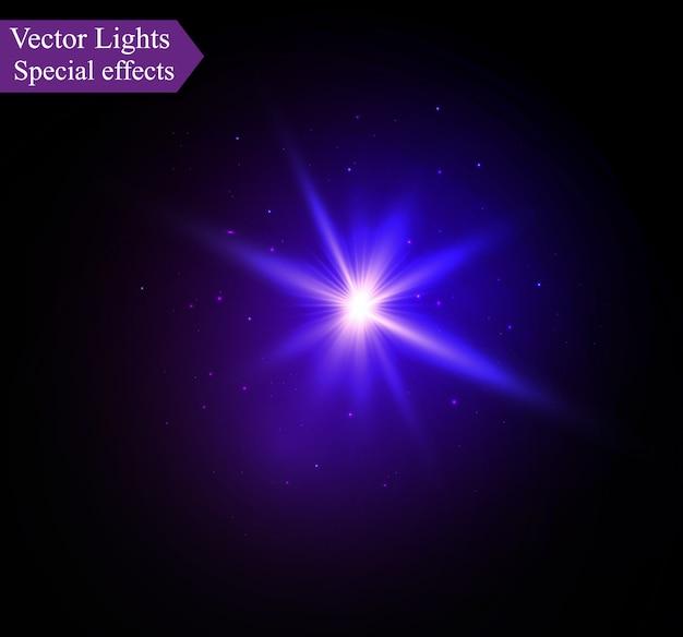Uma luz azul brilhante explode em um fundo preto. partículas de poeira mágica cintilantes. estrela brilhante.