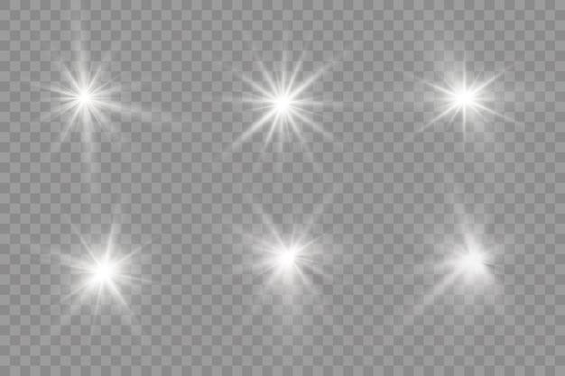 Uma luz branca brilhante explode em um fundo transparente. estrela brilhante. flash brilhante transparente
