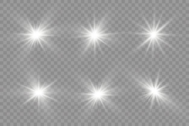 Uma luz branca brilhante explode em um fundo transparente. estrela brilhante. sol brilhante transparente, flash brilhante