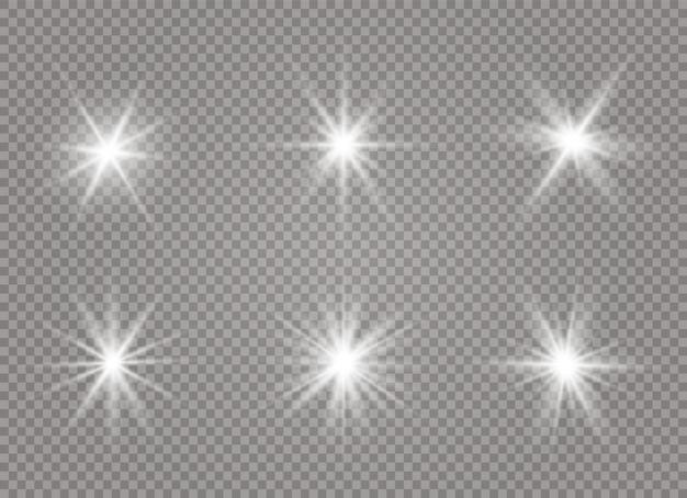 Uma luz branca brilhante explode em um fundo transparente. partículas de poeira mágica cintilantes. estrela brilhante. sol brilhante transparente, flash brilhante