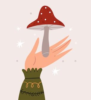 Uma mão em um suéter quente segura um amanita. ilustração bonita do outono.