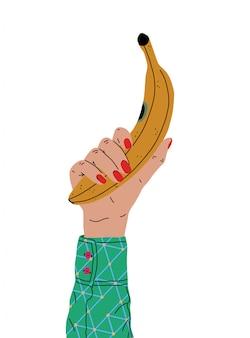 Uma mão feminina com uma bela manicure segura uma banana. vista lateral. ilustração em vetor moderno em estilo cartoon. design plano.