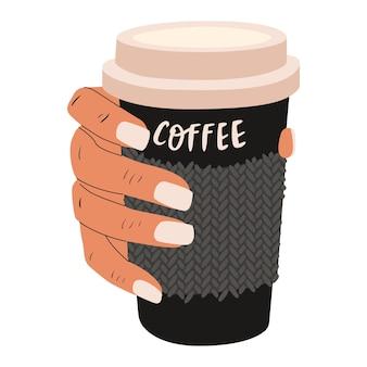 Uma mão segura um café para viagem. o conceito de uma manhã alegre e uma pausa para o café.
