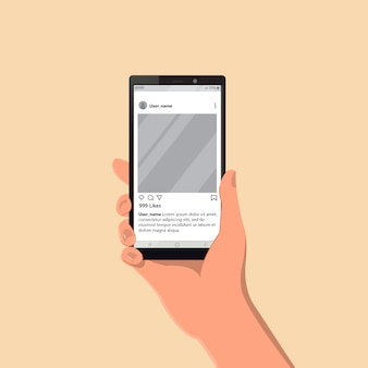 Uma mão segurando um smartphone mostrando a mídia social